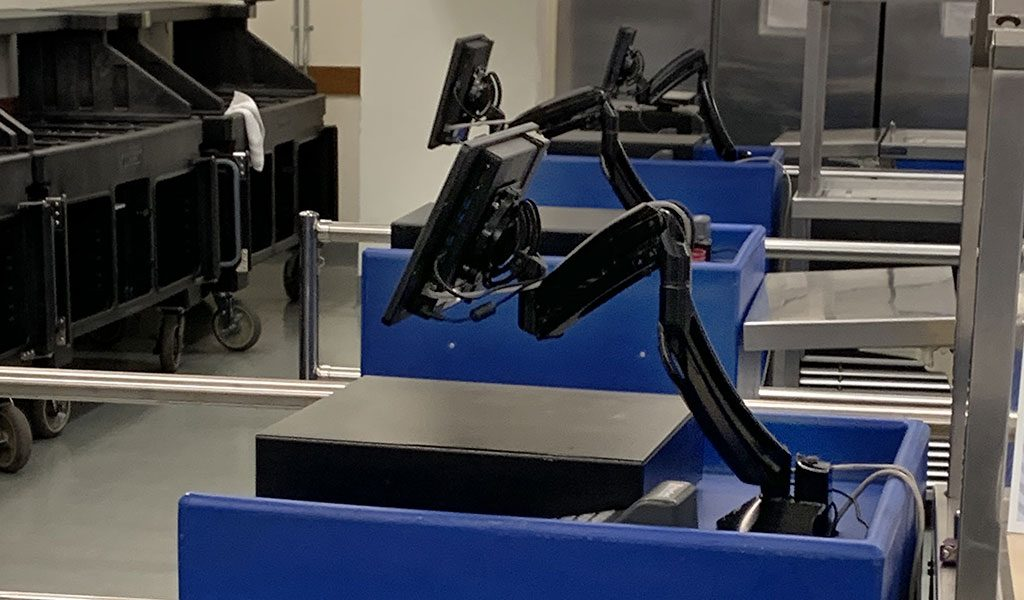 Row of Tablets on articulating arms as POS terminals