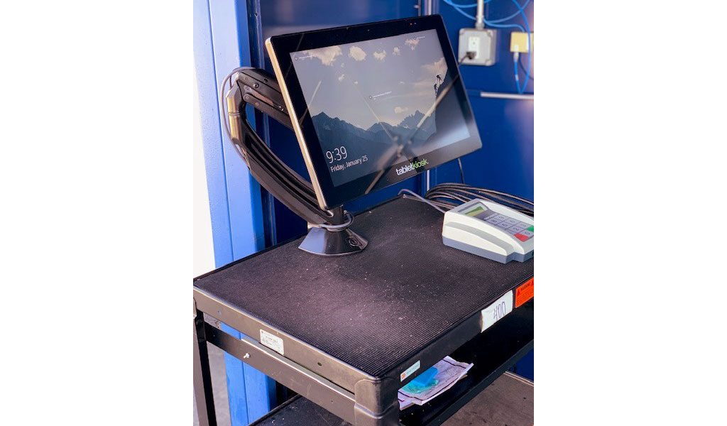 POS terminal attached to a cart with a dynamic desk mount