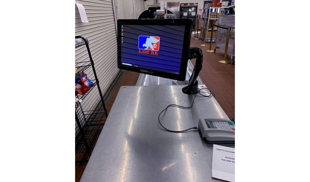 POS terminal attached to counter with keypad