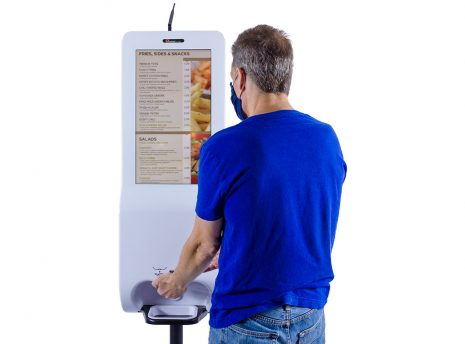 """21.5"""" Hand Sanitizer and Digital Signage Kiosk with Integrated Temperature Scanner (free standing) in use"""